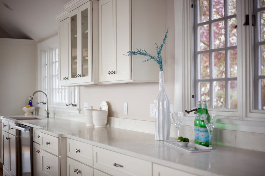 medallion kitchen cabinetry white shaker style glass door panel bump out