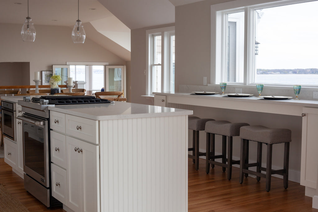 medallion kitchen cabinetry white shaker style beadboard seating