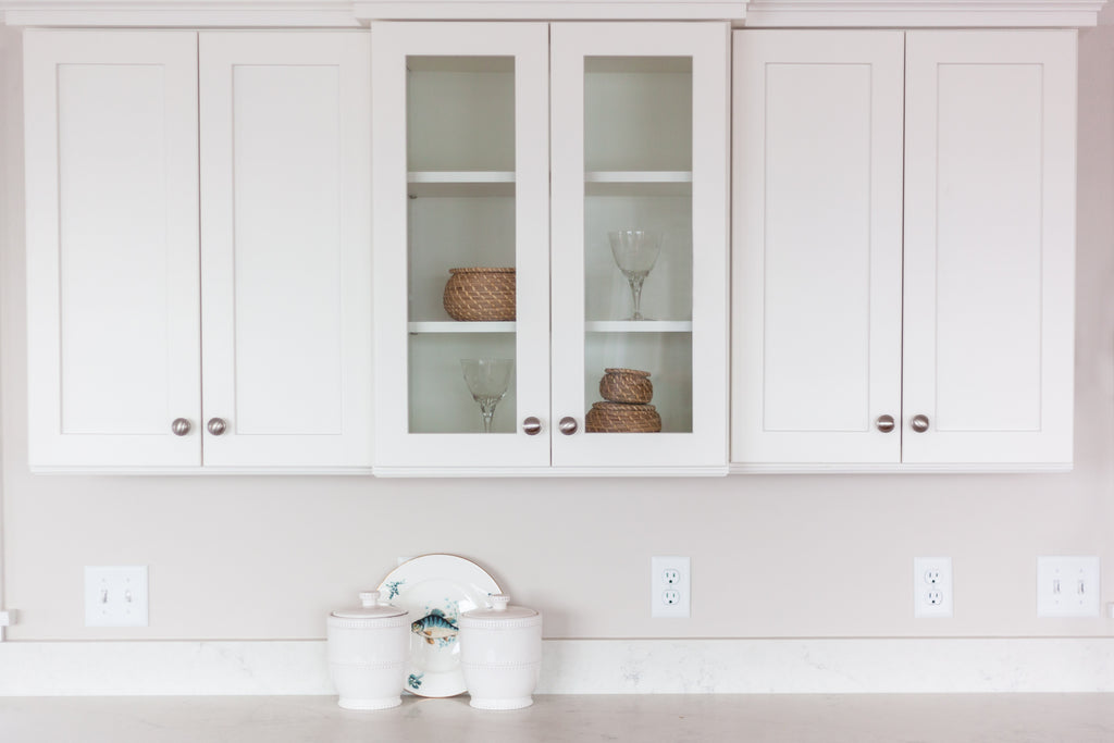 White cabinetry with satin chrome knobs