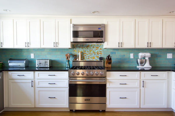medallion cabinetry viking stove blue teal ceramic backsplash tile