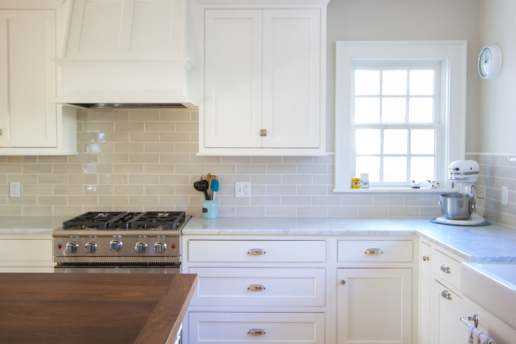 White Shaker Style Kitchen Cabinetry, Marble Countertops Walnut Island