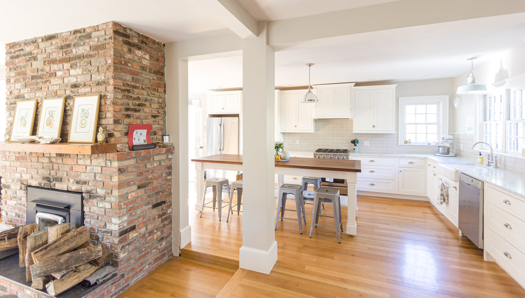 White Shaker Style Kitchen Cabinetry Exposed Brick