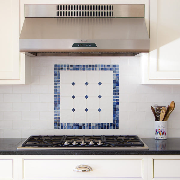 tile backsplash blue pattern above gas stove