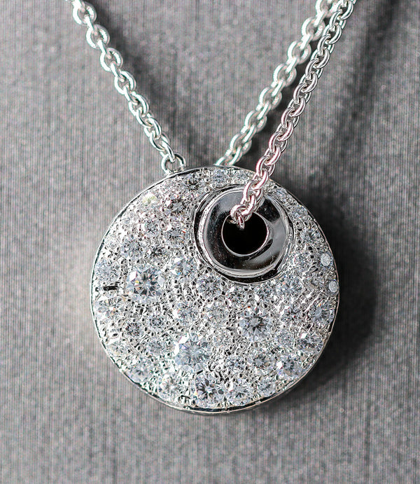 18K White Gold and Diamond Necklace. It has a round pave set diamond pendant. 1.32 ctw.