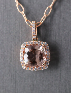 18K Rose Gold and Morganite Stone Necklace. The center Morganite stone is cushion shaped and it is surrounded by a halo of micropave set diamonds.  Total weight 0.30 ctw on a rose gold cable chain.