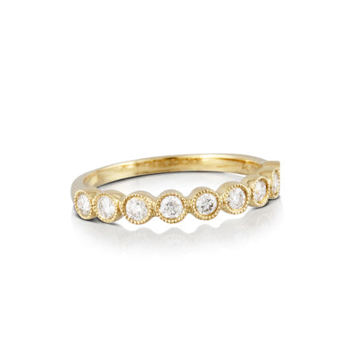 18K Yellow Gold 9 Diamonds Ring with a total diamond weight of .35cts.