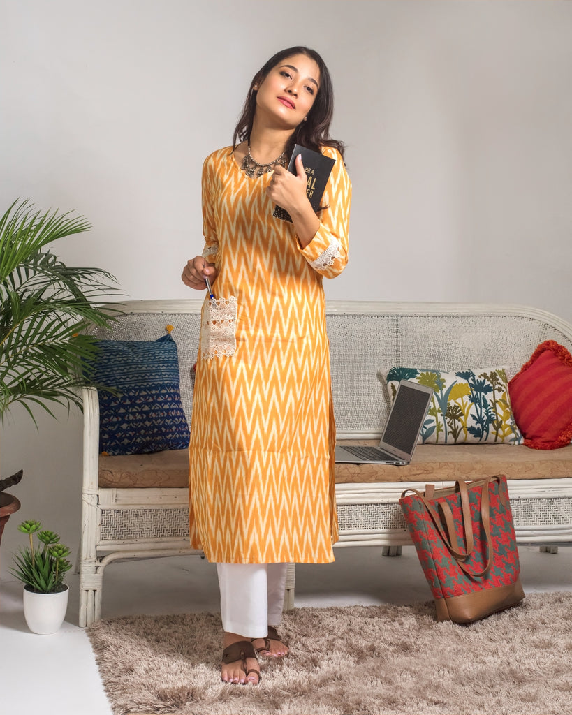 Kurta Set: Mustard yellow Ikat Print Kurta with lace details and white straight pants