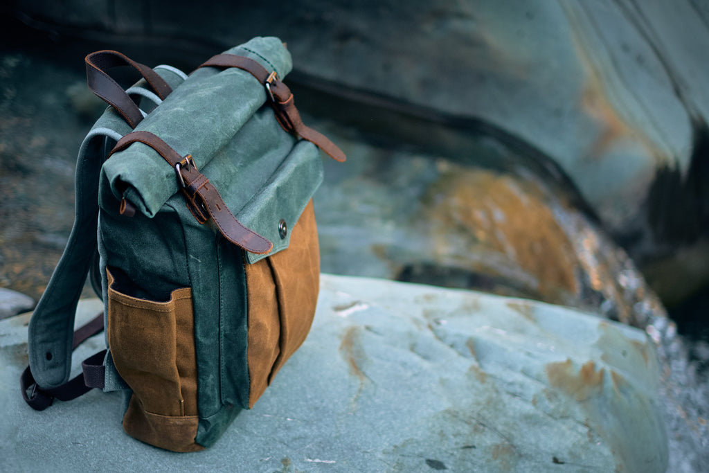 Lund canvas roll top bag on a rock