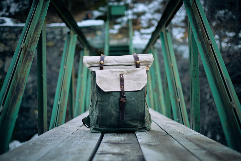 Ladies Canvas Backpack on a bridge