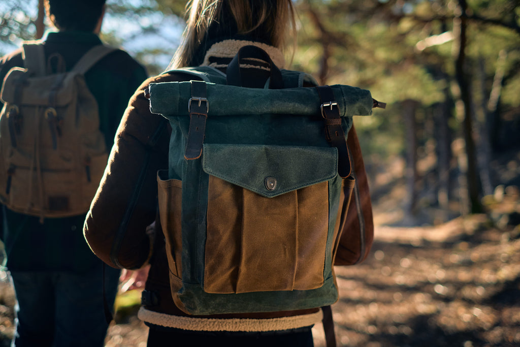 Lund canvas roll top backpack on a woman back