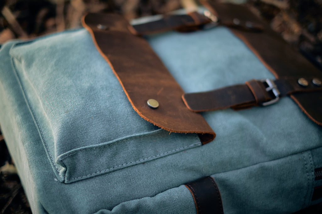 helsinki travel canvas leather backpack from eiken layinig on the floor