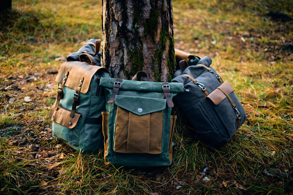 Lund canvas roll top bag with other canvas rucksacks