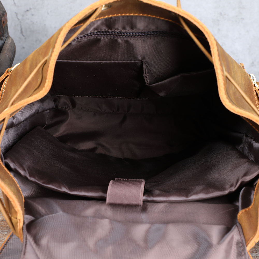 laptop compartment and inner pocket of the coffee leather backpack