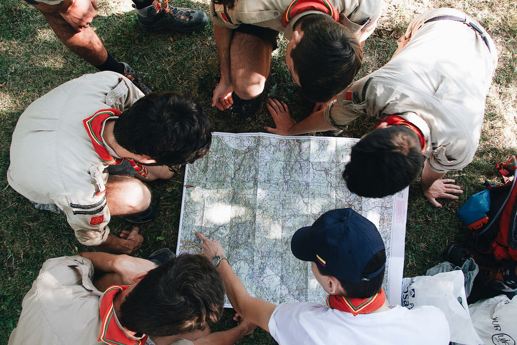 scouts looking at a map
