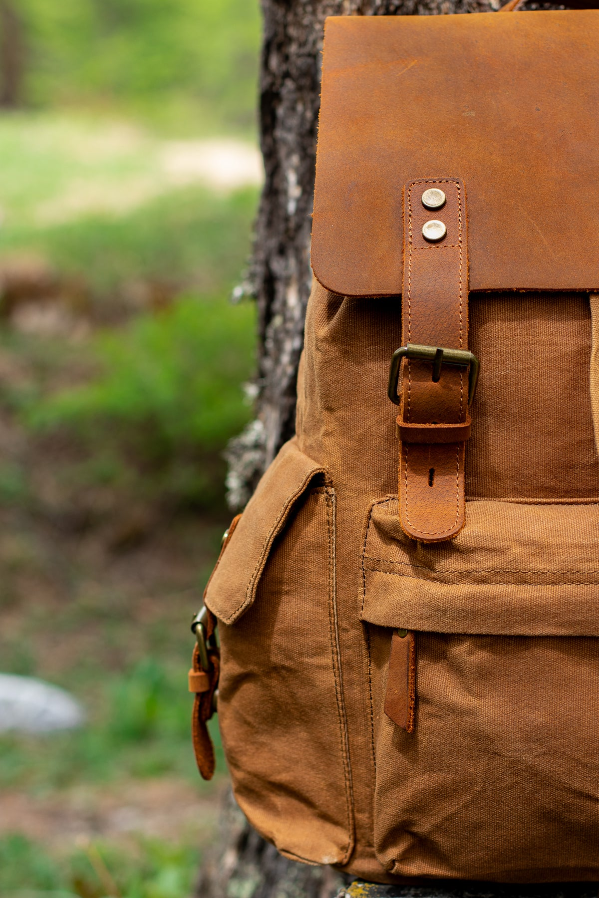 spacious front zipper pocket of the waxed cotton canvas and full grain leather backpack from eiken