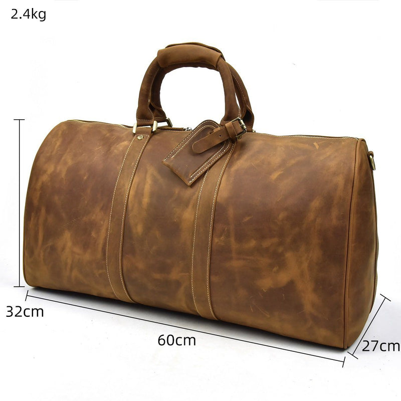 brown leather holdall bag
