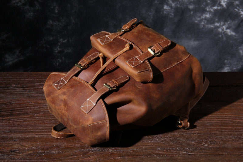 brown leather knapsack