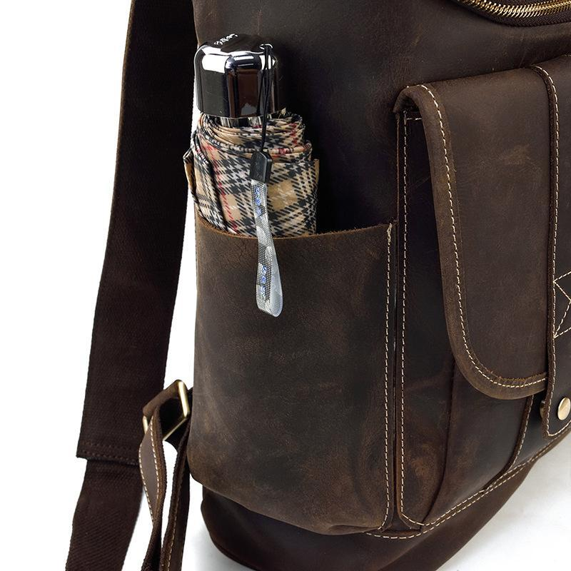 leather school backpack side pockets
