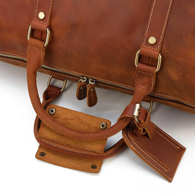 light brown leather duffle bag