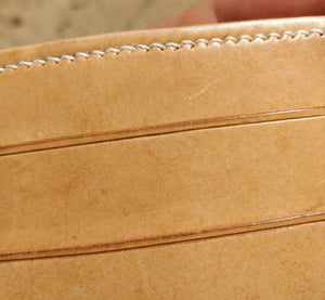 Close up of the upgraded stitching in off-white thread and the edge finishing on the card pockets