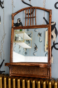 Rattan mirror with shelf