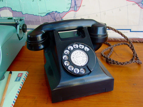 Telephone , Working 1940's Bakelite with black dial face