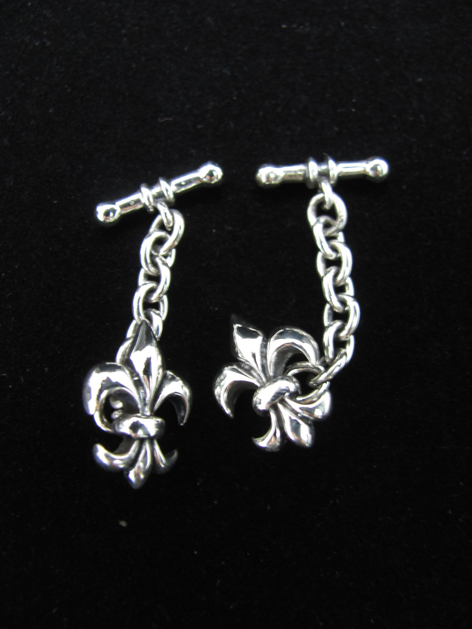 Fleur de lis cufflinks with chain
