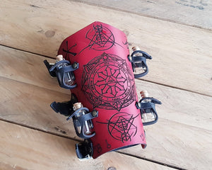 Alchemist bracer with Elemental Sigils.