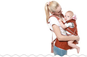 Red ergonomic baby carrier for infants and toddlers