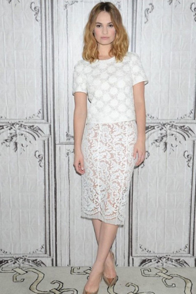 Lily James wears a Galvan lace skirt and top in New York
