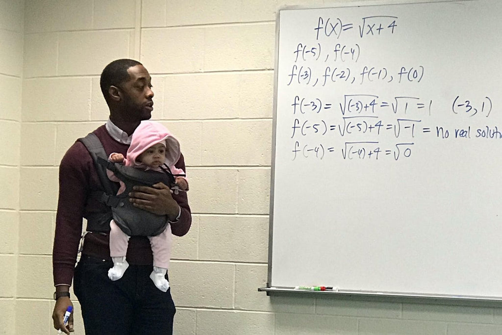 Morehouse Professor Holds Student's Baby During Class so Father Can Take Good Notes