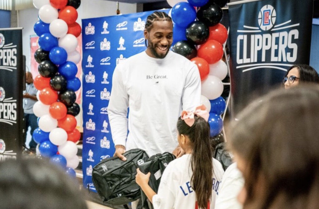 NBA Superstar Kawhi Leonard Gives Away 1 Million Bookbags to Students in Los Angeles