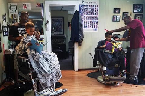 Here's the barbershop that has a literacy program for their child customers