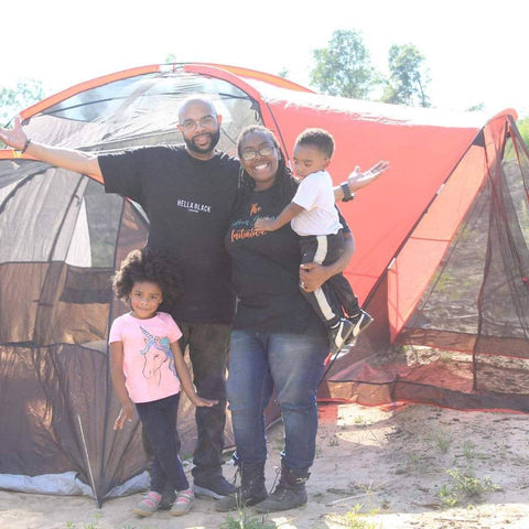 Black Family (Man, Woman and children boy in mothers arms and girl standing next to father) at Toomsboro Camping Trip