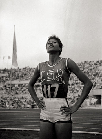 Wilma Rudolph at the olympics with her hands on her hips