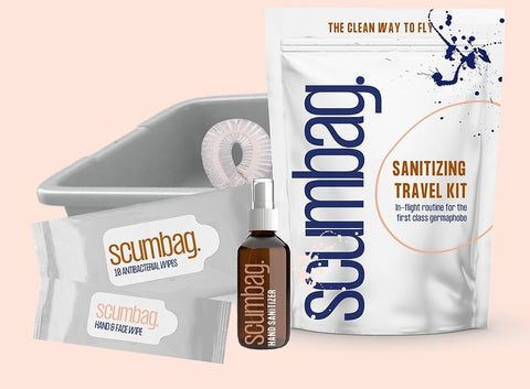 "A photo of the SCUMBAG Sanitizing Travel Kit and what it includes: TSA approved 3oz. hand sanitizer Security Tray cover Antibacterial wipes Cleansing Towlette Each kit also includes an ""air travel cheat sheet"" that details how to best use your SCUMBAG and places to avoid when traveling."
