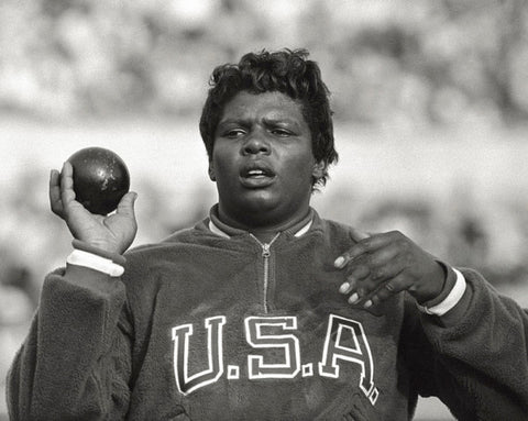 Earlene Brown holding the shot put