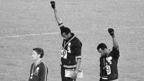 Tommy Smith and Juan Carlos with their fists in the air at the 1968 olympics