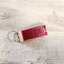 Load image into Gallery viewer, Hate is a virus key fob and bookmark set