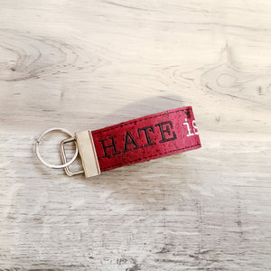Hate is a virus key fob and bookmark set