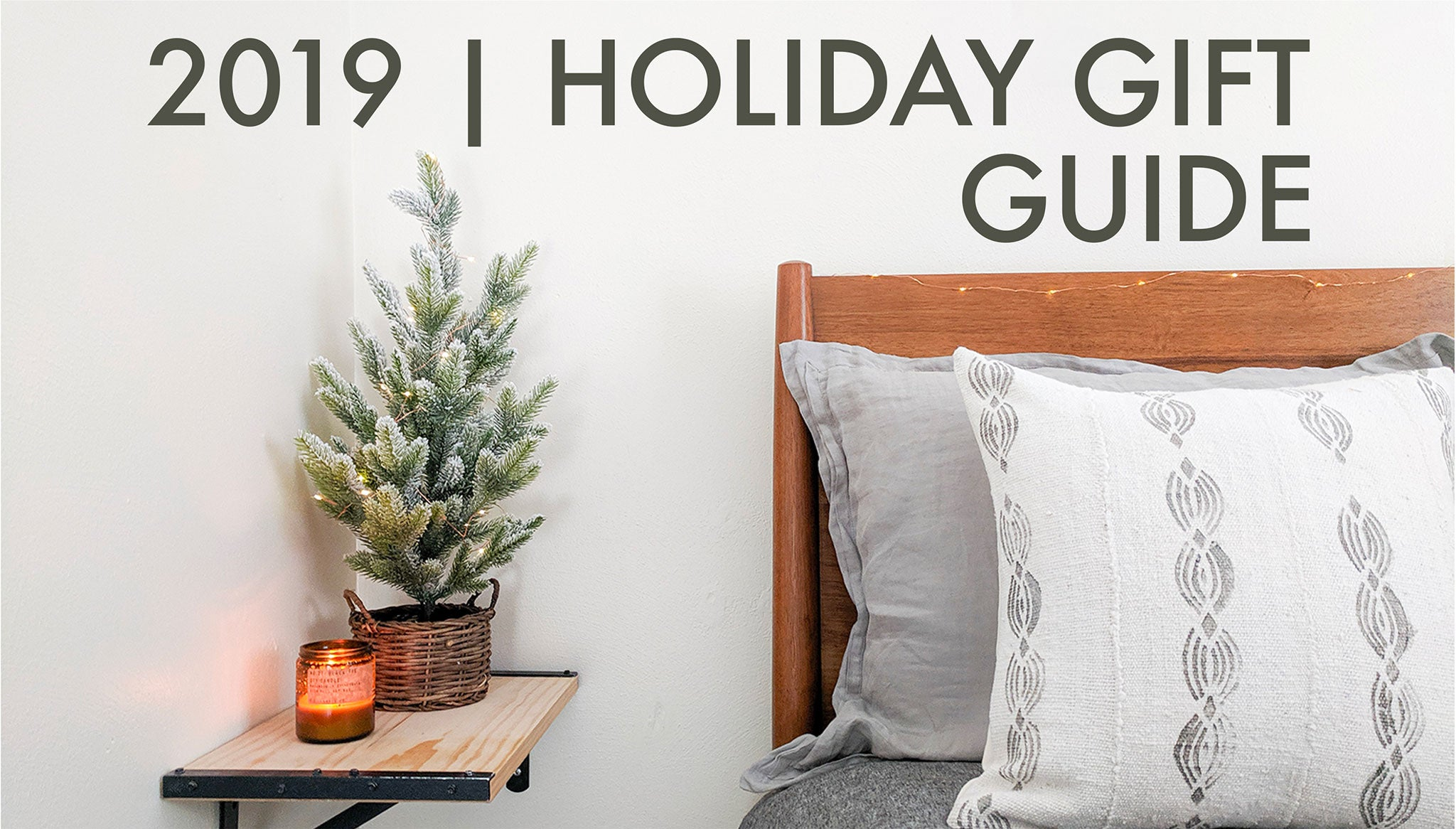 2019 Holiday Gift Guide by Colin and Finn with cream mud cloth pillow and amber glass soy candle
