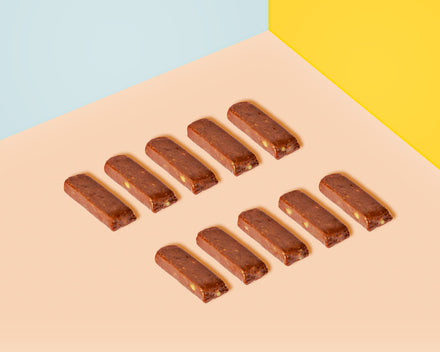 Naked Ginger Nut Wholefoods Bars all lined up in a row