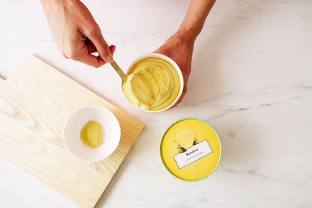 Scooping the Healthy Snack Banana Superfood Purée into a bowl for a healthy breakfast meal or snack