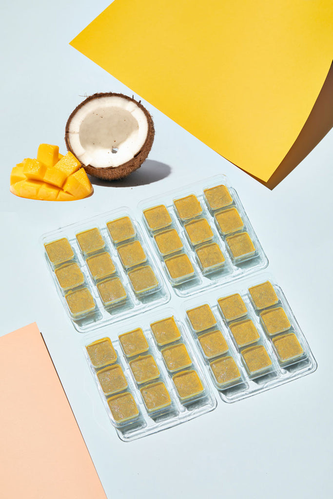 Frozen Mango Coconut Smoothie Cubes in their trays ready for your smoothie blender