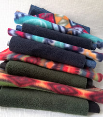 Patterned and plain fleece fabrics paired ready to make winter pillbox hats