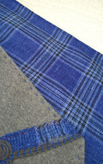 Grey wool and bright blue check fabric being made into a cravat