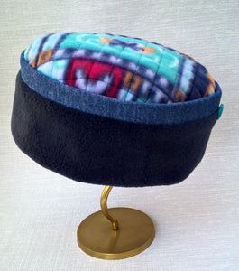 A colourful winter fez handmade in fleece and denim