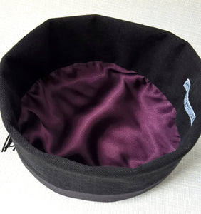 The interior of the smoking cap is hand-finished with an aubergine satin lining