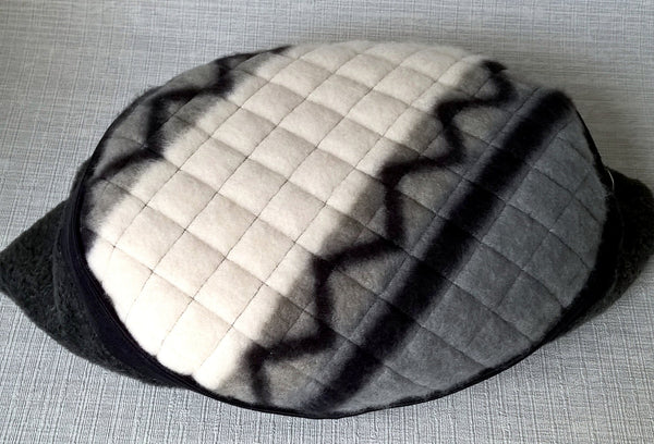 This tribal mens fleece cap has the signature TwiLd Capit Hog quilting