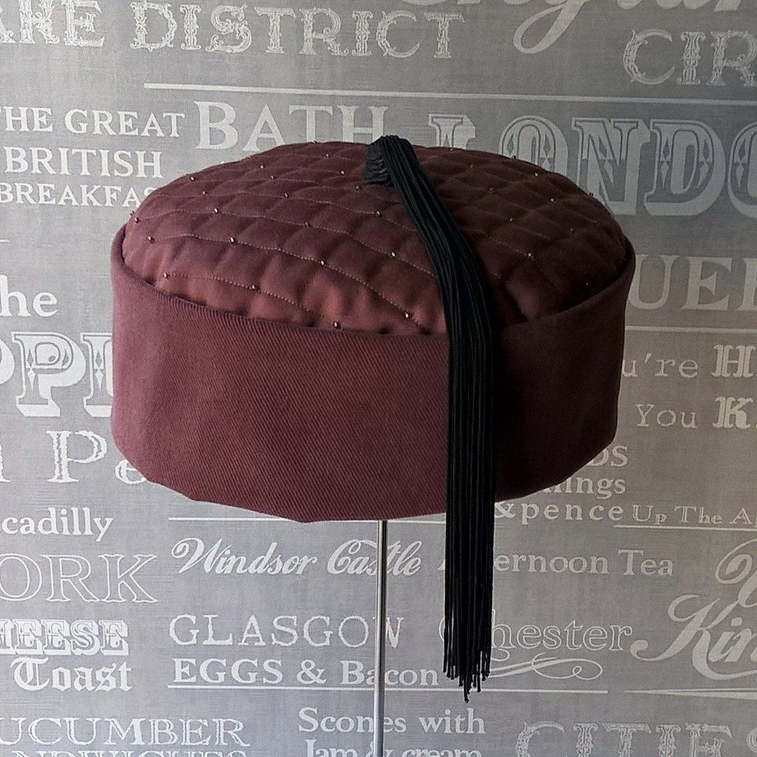 Quilted pillbox smoking cap in maroon with black tassel by TwiLd Capit Hog